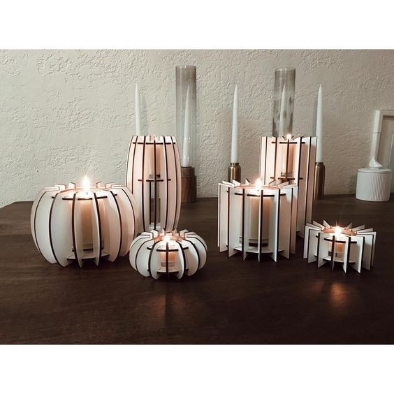selection of laser cut candle stands